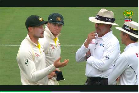 Smith looks on as Bancroft attempts to conceal the truth